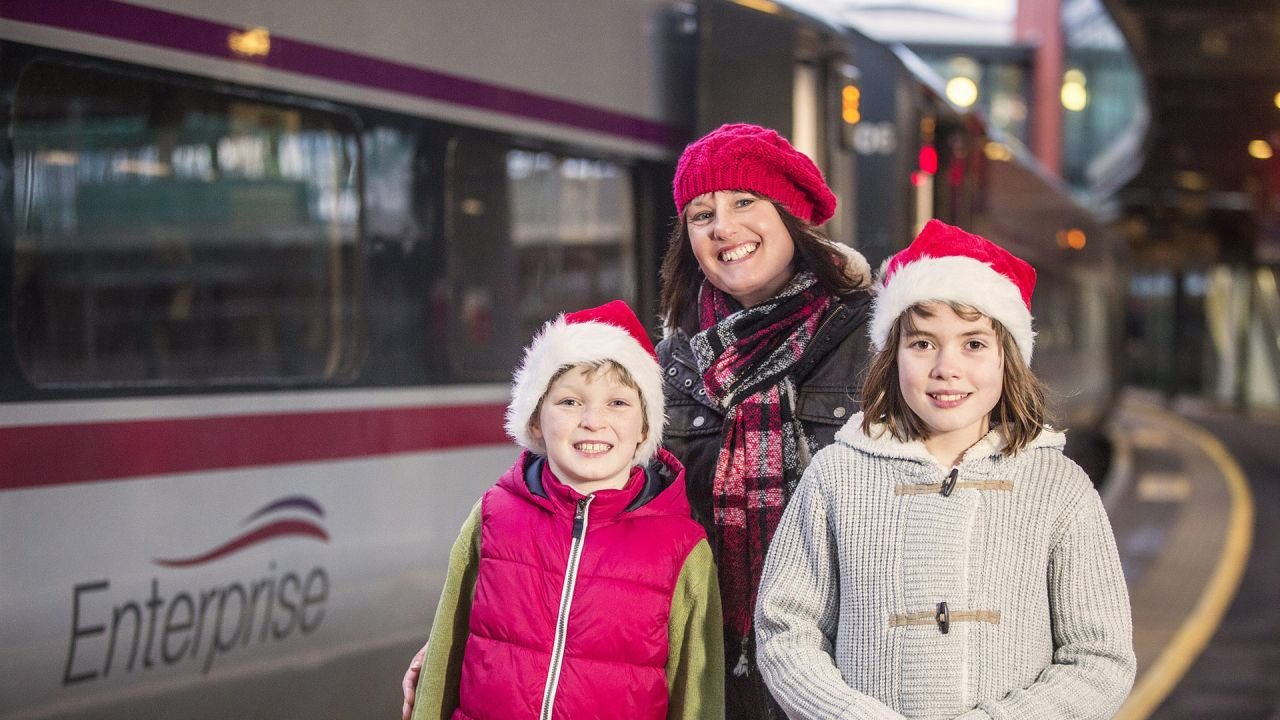 Family travelling on Enterprise train at Christmas