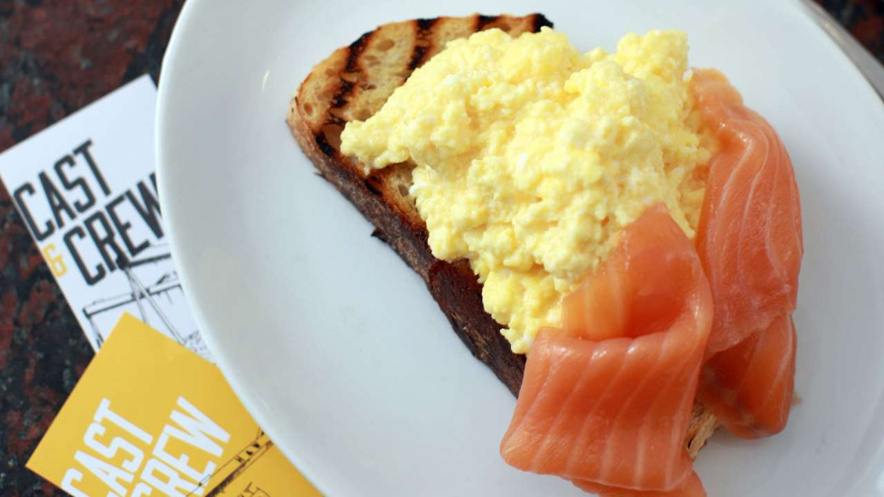 Cast & Crew breakfast with scrambled eggs on toast with smoked salmon