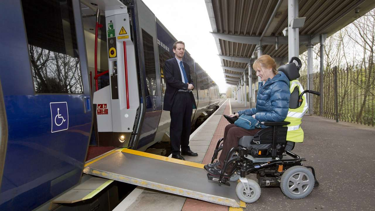 Women in wheelchair using Translink train.jpg