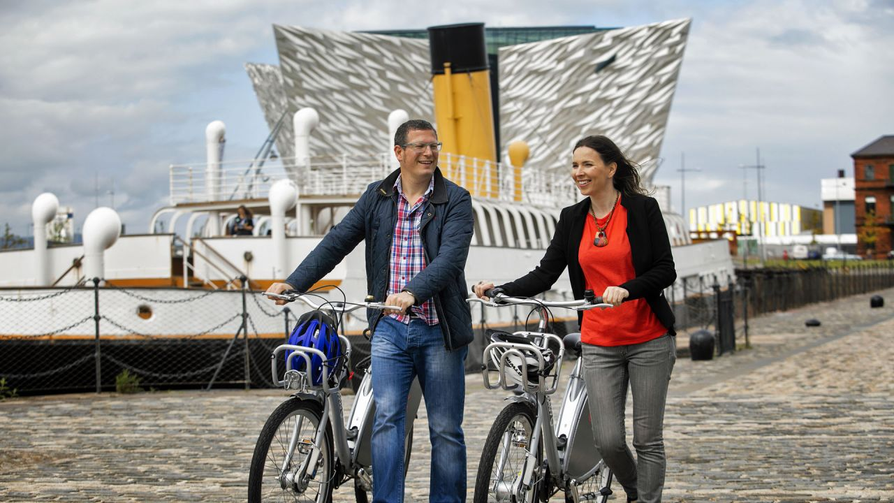 Couple Riding Bikes at Titanic Belfast