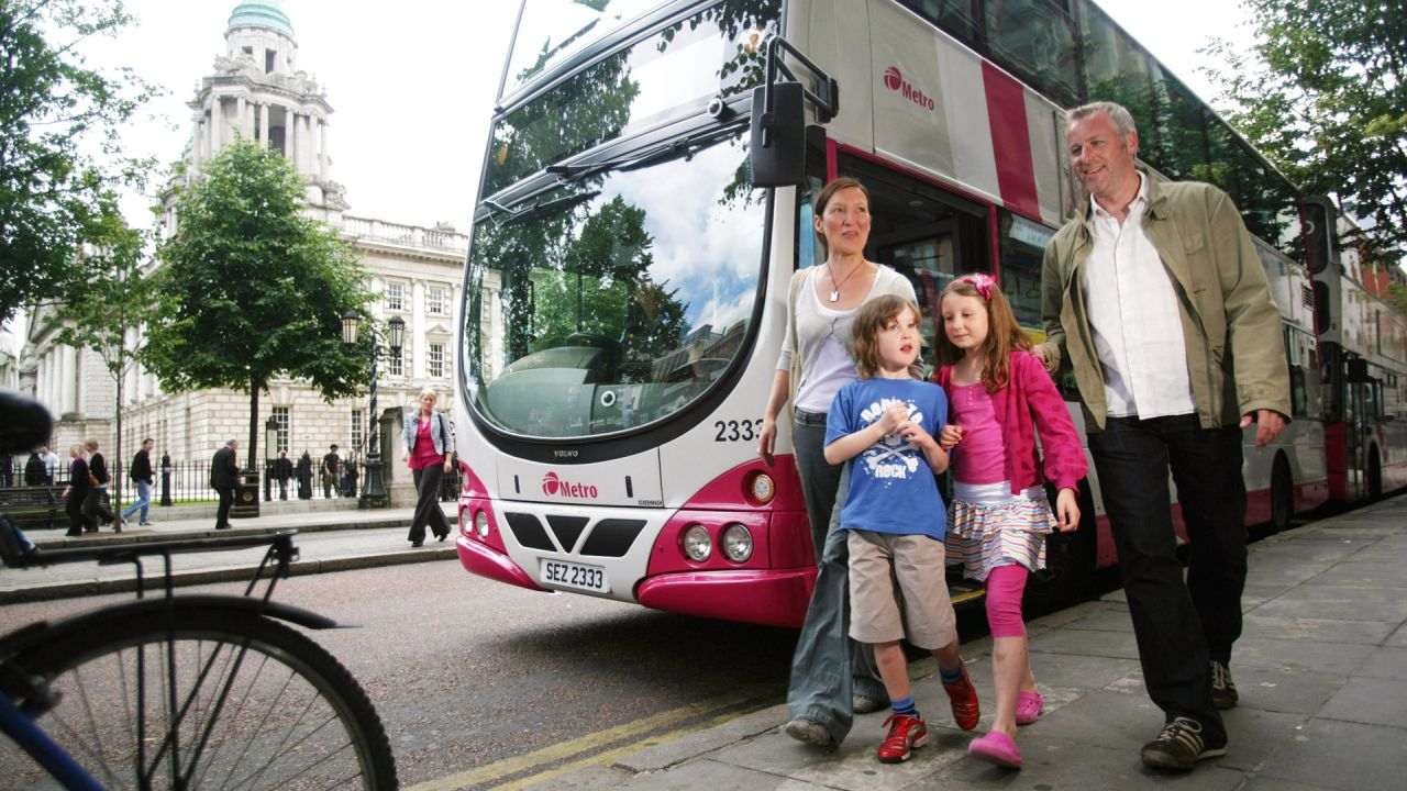 Family using Translink Metro Bus